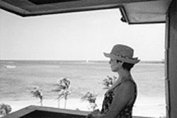 Donna looks out onto the Bahamian waters from her hotel balcony in Nassau.