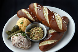 Philly pretzel bread — house-made devilled ham and Bell's stout cheese spread.