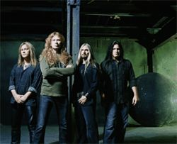 Megadeth&#039;s Dave Mustaine (second from left) keeps his soloing hand warm.
