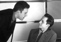 Ben Affleck (left) demonstrates for Giovanni Ribisi the art of the sale