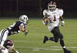 Jarvis Hicks runs the ball for Salisbury, with his good friend and roommate Zach Johnson blocking up front.