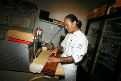 Kamioka, owner and sushi chef, readies the tools of his trade.