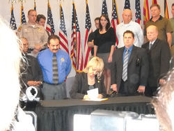 Gov. Jan Brewer signing Senate Bill 1070.