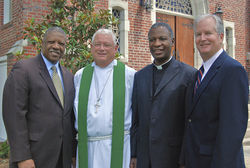 Winds of Change partner Julius Jackson Sr. (left) hosted Archbishop Thabo Makgoba (second from right) at an Anglican church service in Jacksonville on June 19.