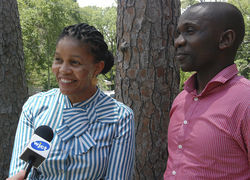 Khumo Shongwe (left) and Mluleki Majola, representatives of Royal Bafokeng Holdings, talked with the media during a recent visit to Jacksonville with the archbishop.