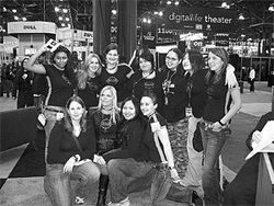 "The PMS Clan with its legendary founder, Amber ""Athena Twin"" Dalton (front row, second from left), at the Electronic Entertainment Expo in L.A."