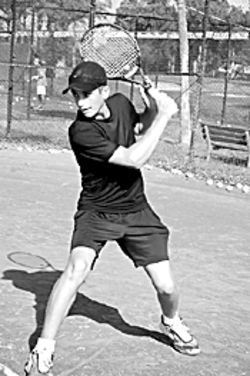 Spencer cocks the trigger on his backhand.