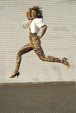 Santogold jumps and dresses like a cheetah.