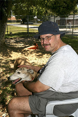 Jerry Berlin, a volunteer with Friends of Greyhounds, has owned seven retired racers. He tries not to think of what his dogs went through before he got them.