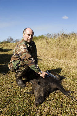 John Powers, another client, poses with his kill