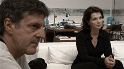 Auteuil and Binoche: Somebody's watching, somebody's taping.