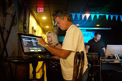 Jimmy Boyd selects his next one-hit wonder during karaoke night at Little Munich in Lake Worth.
