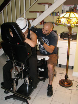 Louie tattoos Dony at his condo in Hialeah this February.