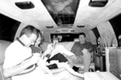 Browne (in white blouse) holds hands with Smyth during a limo party on Saint Patrick's Day. The FBI identifies the man in the foreground as Conor Claxton, but Browne insists it's really Smyth's brother-in-law.