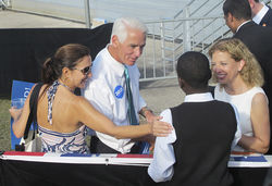 Crist; his wife, Carole; and Rep. Debbie Wasserman Schultz greet fans at a rally in Hollywood.