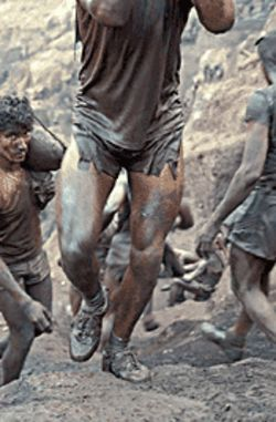 Hot-legged gold miners (like the ones in this photo by Alfredo Jaar) are among the eye candy youll see 