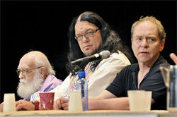 Randi, Penn, and Teller pose in thought during a panel discussion on magic and skepticism.