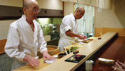 Sushi chef Jiro Ono, left, works the line at his famed restaurant.