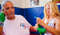 Khalilah gets her hand wrapped by Jolie Glassman of South Florida Boxing Gym in Miami Beach, where she trains to stay in shape.