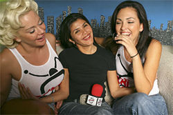 Gi Gi Cruz (center, below) looks innocent enough, but guess how many photos of breasts are stored in her cell phone.
