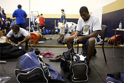 Senior linebacker Phil Walker packs for the trip in the weight room.