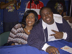 Sean and his mother pose during a CD signing at the BankAtlantic Center.