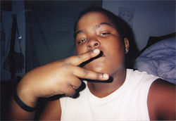 Kisean practicing his peace sign at age 12.
