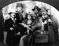 "The gang in a gag photo taken in New Orleans, from left: Rafael Cardona Salazar; Mickey Munday; Rafa's wife, Odelia; Medellin Cartel associate ""El Negro""; and Max."