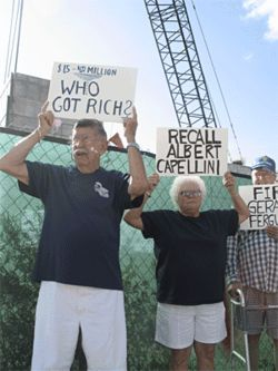 "More than a dozen seniors picketed at the ""Capellini's Castle"" construction site."