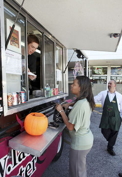 "Cook Michael Nerio takes an order from Katie Phipps, who drove 22 miles to get a Latin ""Macho"" Burger."