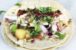 The Spring Break Taco: grilled fish with island pineapple slaw, sweet chili oil, and chipotle sour cream.
