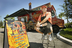 Rolling Stove owner Troy Thomas parks his food truck on weekends at Bedner's Farm Fresh Market in Boynton Beach.