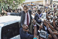 "Haitian president Michel ""Sweet Micky"" Martelly waves to fans in Port-au-Prince."