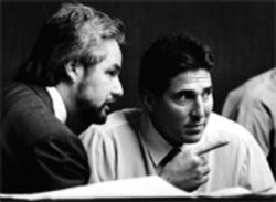 Attorney John P. Contini talks to Gil Fernandez during the 1991 murder trial.
