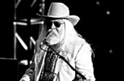 No, it's not Santa.  It's Leon Russell.