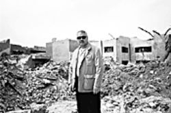Martin searches a bomb crater in the Mansur neighborhood of western Baghdad for the displaced despot