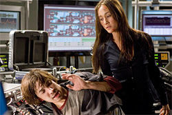 Menacing blackout plotter (Maggie Q) meets cringing hacker (Justin Long).