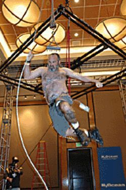 Gus Diamond thrashes in midair suspended by six hooks in his shoulders.
