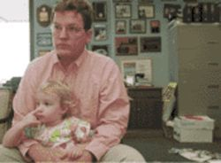 Mayor Naugle (with daughter Rachel in city hall) is putting all his might -- and his bogus standing as a Democrat -- into putting another Bush in the White House