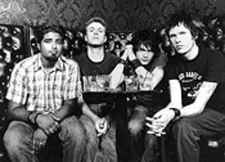 The whole of Sum 41: Dave Baksh (left), Steve Jocz, Deryck Whibley, and Cone McCaslin
