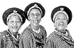 Up from apartheid: The Mahotella Queens (from left) Nobesuthu Mbadu, Hilda Tloubatla, Mildred Mangxola