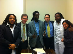 Stephen Marley, left, who put his house on the line to spring Buju from lockup between trials, along with Buju, his legal team, and performer Roy &quot;Gramps&quot; Morgan.