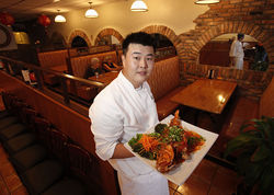 Executive chef Mike Kwon shows off the whole fried snapper.