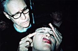 Terra gets a &quot;massage&quot; from the Rev. Kim Fowley.