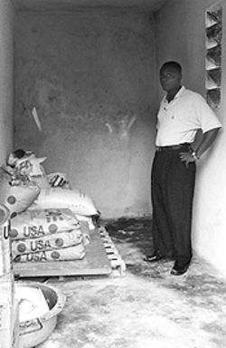 Orphanage owner Milhomme Luckner with his depleted food supplies