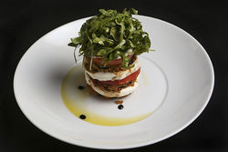 The eggplant stack ($14) features perfectly crisp disks of fried eggplant with  tomatoes and mozzarella.