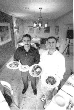 "Brothers Famer (left) and Ahmad Barazi welcome diners to the ""Home of the Kabob"""