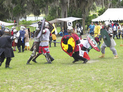 Heavy-weapons fighters battle it out in a melee in which two sides face off in large-scale combat.