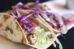 Triple Eight Lounge: Veracruz-style fish tacos: seared mahi, pico de gallo, and crema Latina.