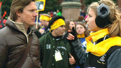 Director Kelly Nyks interviews a protester at a Roe v. Wade rally.